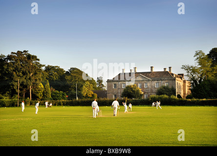 Evening at a village cricket match at North Nibley cricket ground Gloucestershire UK - Stock Photo