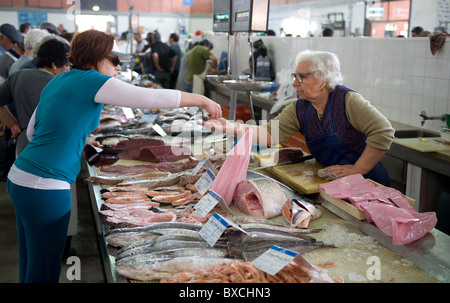 Fish market in a market hall in Olhao, Portugal - Stock Photo