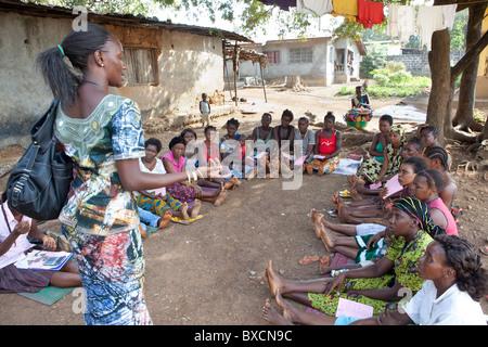 Women attend a community meeting in Freetown, Sierra Leone, West Africa. - Stock Photo