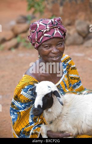 A villager (Mrs. Mayni Kamara) poses with her sheep in Port Loko, Sierra Leone, Liberia. - Stock Photo