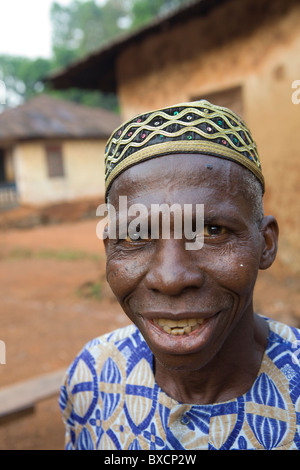 Village chief in traditional garb - Port Loko, Sierra Leone, West Africa. - Stock Photo