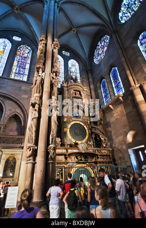 The Angel's Pillar or Judgement pillar and the astronomical clock, Notre-Dame gothic cathedral, Strasbourg, Alsace, - Stock Photo