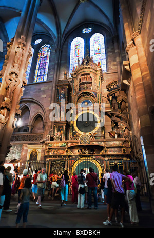 Astronomical clock and tourists, Notre-Dame gothic cathedral 14th century, Strasbourg, Alsace, France - Stock Photo