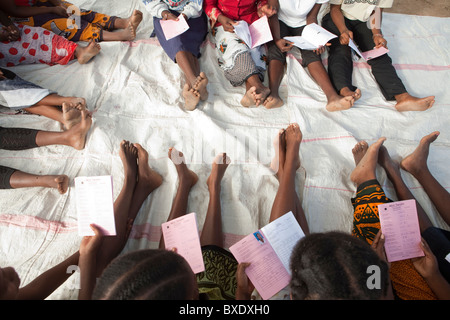 Women attend a community meeting in Dodoma, Tanzania, East Africa. - Stock Photo