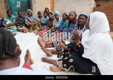 Women attend a community meeting in Iringa, Tanzania, East Africa. - Stock Photo