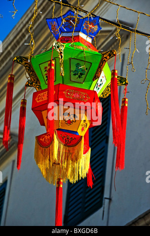 Paper Chinese lantern hanging on city street in downtown in Macau Hong Kong China - Stock Photo