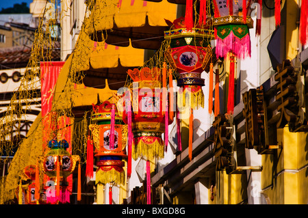 Paper Chinese lanterns hanging on city street in downtown in Macau Hong Kong China - Stock Photo