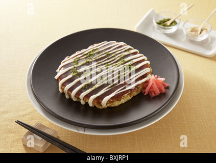 Japanese pancake, Okonomiyaki - Stock Photo
