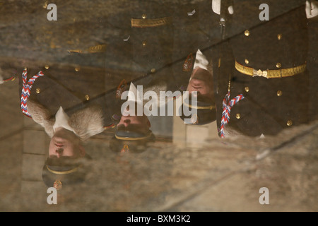 Reflection of the Presidential Guard of Honour in winter uniform at the Prague Castle in Prague, Czech Republic. - Stock Photo