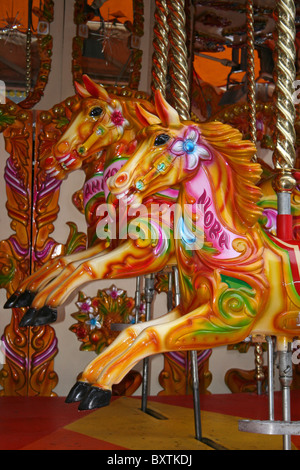 Colourful Painted Horses On A Fairground Carousel Ride, Taken In Liverpool, UK - Stock Photo