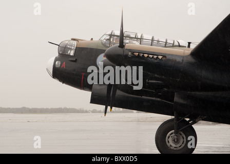 The Avro Lancaster X of the Canadian Warplane Heritage Museum being readied for take off in Hamilton Ontario, Canada. - Stock Photo