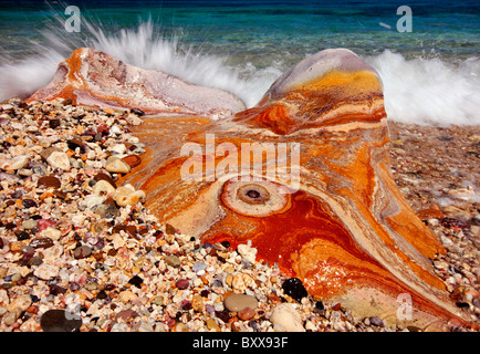 A 'psychedelic' volcanic rock in Kastanas beach, Milos island, Greece - Stock Photo