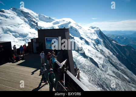 Aiguille du Midi viewing platform at 3842 m with Mont Maudit and Mont Blanc in the distance. Near Chamonix, French - Stock Photo