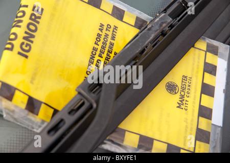 Parking ticket held under wiper blade.Manchester,UK. - Stock Photo