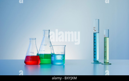 Beakers and flasks with colorful liquids - Stock Photo