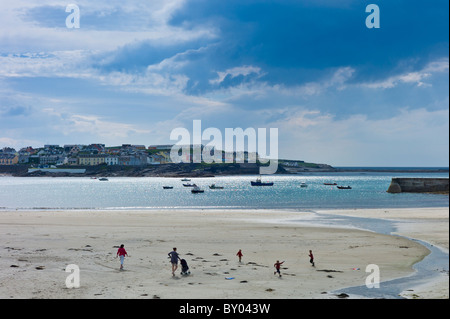 Women with children play on the strand in Kilkee bay popular beach resort, County Clare, West Coast of Ireland - Stock Photo