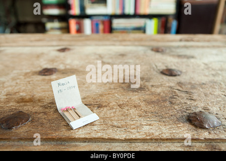Phone number on a matchbook - Stock Photo