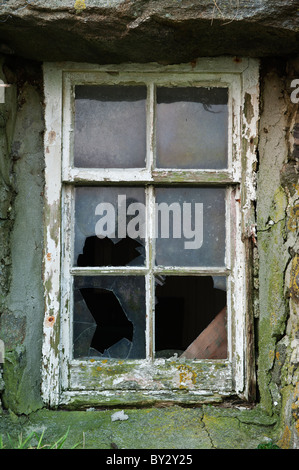 Exterior broken window of derelict croft house, Berneray, Outer Hebrides, Scotland - Stock Photo
