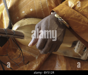 Closeup of Chieck Hamala Diabate, an African Griot musician  from Mali playing a ngoni, a precursor of the American - Stock Photo