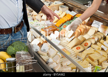 A customer and clerk in a wine and cheese shop - Stock Photo