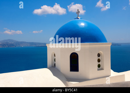 Oia, ( Ia ) Santorini - Blue domed Byzantine Orthodax churches, - Greek Cyclades islands - Photos, pictures and - Stock Photo