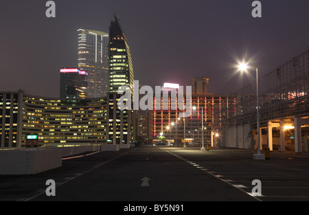 Empty parking lot in the city at night, Hong Kong - Stock Photo