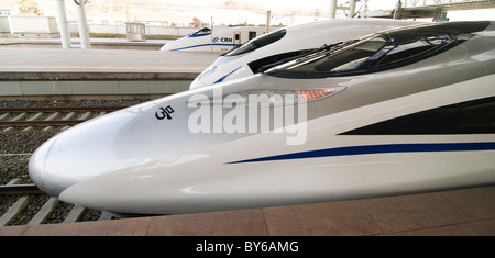 Super new Chinese bullet trains at Nanjing railway station. - Stock Photo