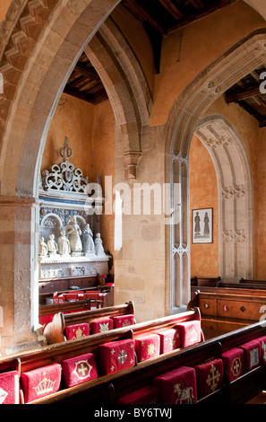 St Michael's Church in the country village of Aldbourne, Wiltshire, England, UK with the Goddard monument through - Stock Photo