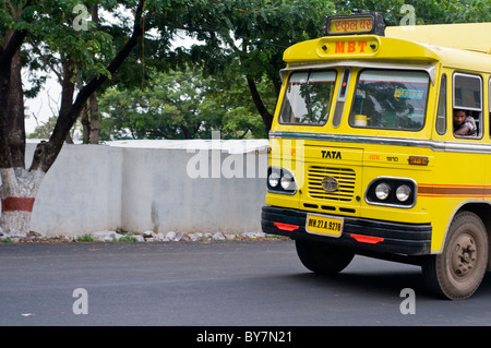A yellow bus on the streets of Bhopal in India - Stock Photo