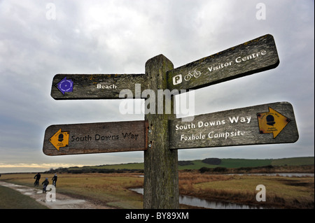 Footpath sign at Cuckmere Haven is an area of flood plains in Sussex  where the river Cuckmere meets the English - Stock Photo