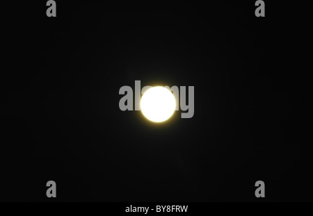 The full Moon in an unflawed sky at night - Stock Photo