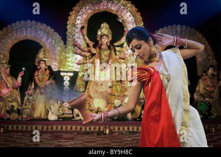 Bengali woman doing a Dhunuchi dance - Stock Photo