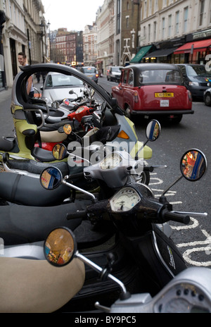 Mopeds Covent Garden Area London England - Stock Photo