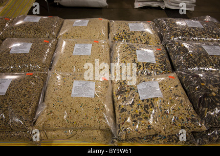 Mounds of bird and pet food for sale at a bird expo. - Stock Photo