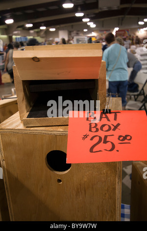 Items for sale at a bird expo. - Stock Photo