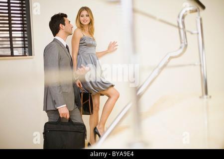 Couple going upstairs - Stock Photo