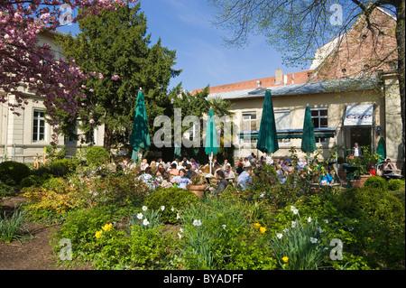 Cafe in the main pedestrian street of the historic town centre, Heidelberg, Neckar, Palatinate, Baden-Wuerttemberg - Stock Photo