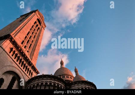 Sunset in Montmartre, Sacré-Coeur Basilica, Paris, France - Stock Photo
