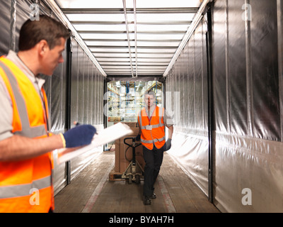 Workers loading truck - Stock Photo