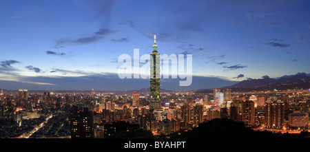 Panoramic city skyline in night with famous 101 skyscraper and buildings in Taipei, Taiwan. - Stock Photo