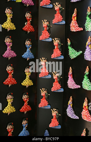 Fridge magnets in the form of Spanish dancers for sale outside souvenir shop in Los Boliches, Fuengirola, Costa - Stock Photo