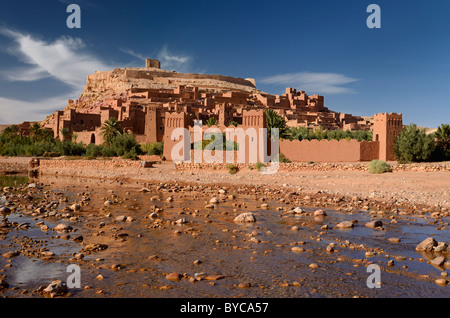 Ancient red city of Ait Benhaddou with shallow water of Ounila River or Wadi Mellah near Ouarzazate Morocco - Stock Photo