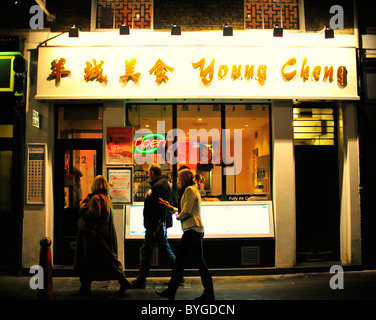 People outside Young Cheng Chinese Restaurant in Chinatown, London - Stock Photo