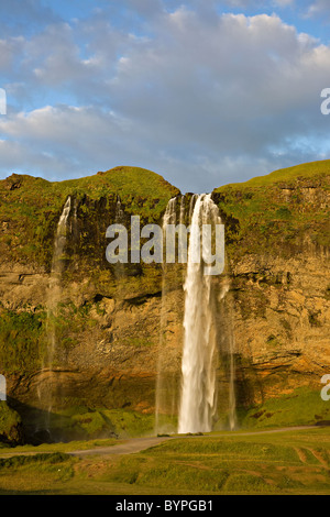 Waterfall Seljalandsfoss in South Iceland, Island - Stock Photo