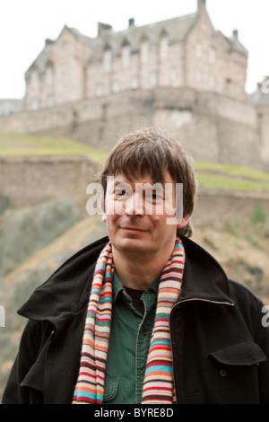 31 January 2011 - Author Ian Rankin Portrait in front of Edinburgh Castle - Stock Photo