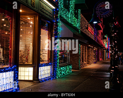 Store fronts on the main street in Rochester Michigan lit up for the Christmas holidays. - Stock Photo