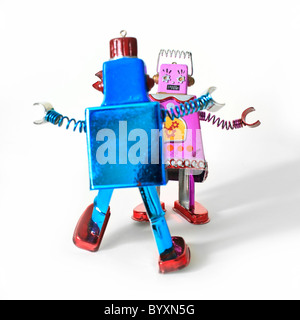 Dancing toy robots, male and female likeness. - Stock Photo