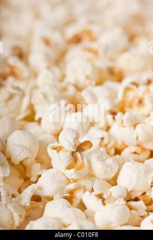 Close-up of fresh popcorn - selective focus - Stock Photo