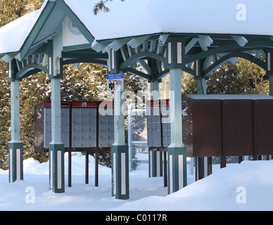 Postal kiosk for mailboxes in country - Stock Photo