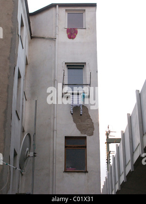 Laundry hanging out of the window to dry, house on the Bahndamm, Ehrenfeld, Cologne, North Rhine-Westphalia, Germany, - Stock Photo